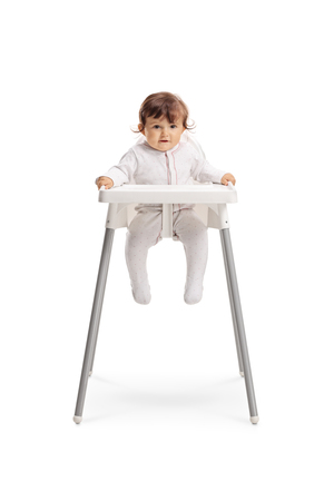 Photo pour Full length portrait of a baby girl sitting in a feeding chair isolated on white background - image libre de droit