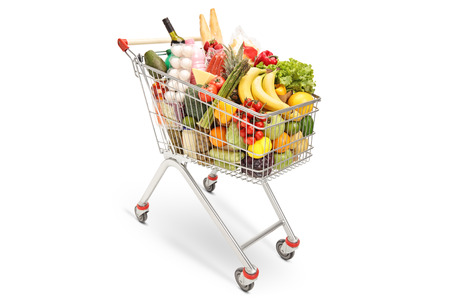 Foto de Shopping cart with different food products isolated on white background - Imagen libre de derechos