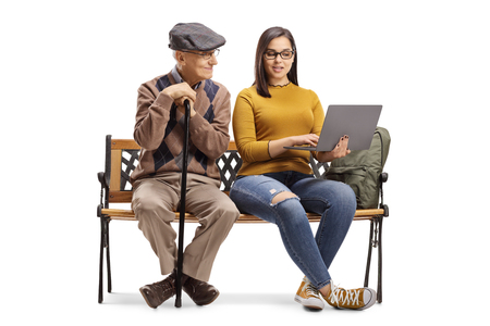 Photo pour Senior man and female student with a laptop sitting on a bench isolated on white background - image libre de droit