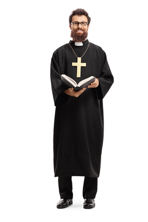 Photo pour Full length portrait of a father priest with a cross and bible isolated on white background - image libre de droit