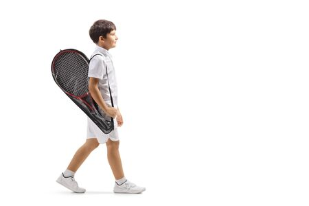 Photo for Full length profile shot of a boy walking with a tennis racket in a case isolated on white background - Royalty Free Image