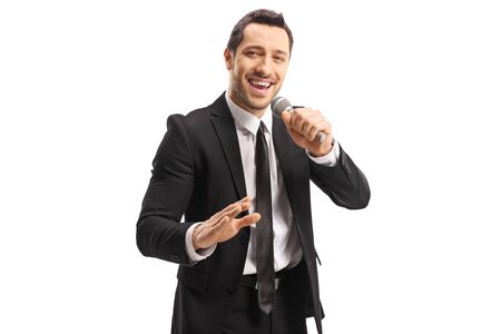Photo pour Young handsome man with a microphone in his hand isolated on white background - image libre de droit