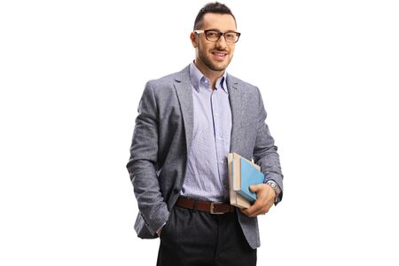 Photo pour Young man holding books and smiling at the camera isolated on white - image libre de droit