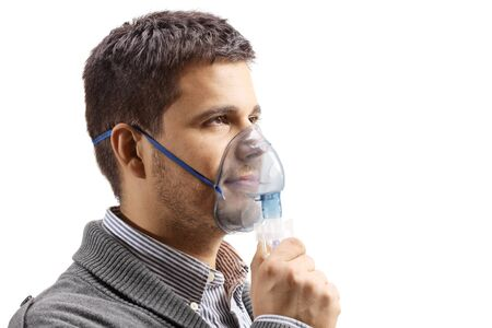 Photo pour Young man with an inhalation mask isolated on white - image libre de droit