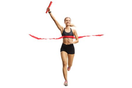 Photo pour Full length portrait of a athlete woman finishing a relay race with a baton in her hand isolated on white background - image libre de droit