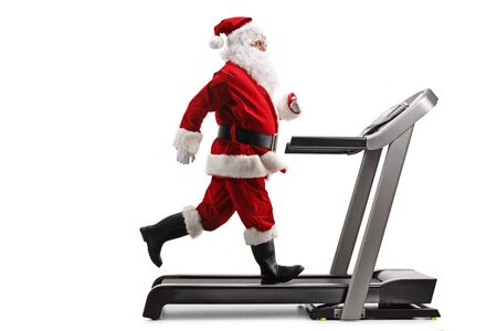 Photo for Full length profile shot of Santa Claus running on a treadmill isolated on white background - Royalty Free Image