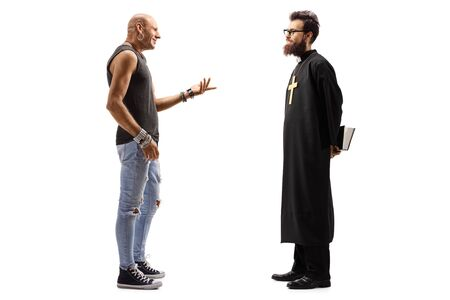Photo pour Full length profile shot of a male hipster talking to a priest isolated on white background - image libre de droit