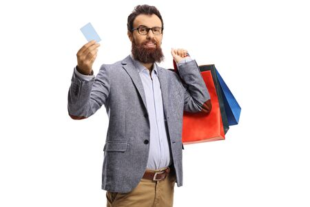 Photo for Bearded man with shopping bags and a credit card isolated on white background - Royalty Free Image