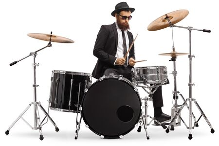 Photo pour Elegant male drummer playing a drumkit isolated on white background - image libre de droit