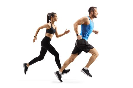 Foto de Full length profile shot of fit man and woman in sportswear running isolated on white background - Imagen libre de derechos