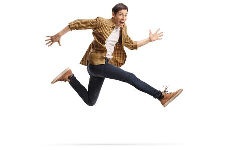 Photo pour Casual happy young man jumping isolated on white background - image libre de droit