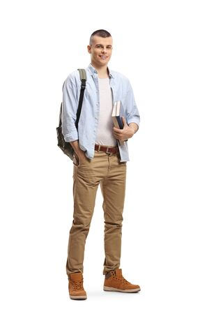 Photo pour Full length portrait of a male student with books and backpack and smiling at the camera isolated on white background - image libre de droit