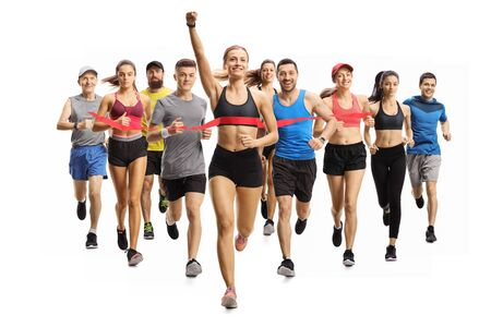 Photo pour Full length portrait shot of people running a marathon race and a young woman finishing first isolated on white background - image libre de droit