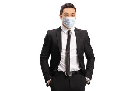 Photo pour Young businessman wearing a protective medical face mask isolated on white background - image libre de droit