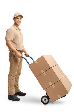 Photo for Full length shot of a delivery man pushing a hand truck with boxes isolated on white background - Royalty Free Image