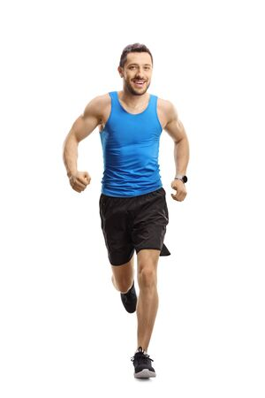 Photo for Full length portrait of a man in sportswear running towards the camera and smiling isolated on white background - Royalty Free Image