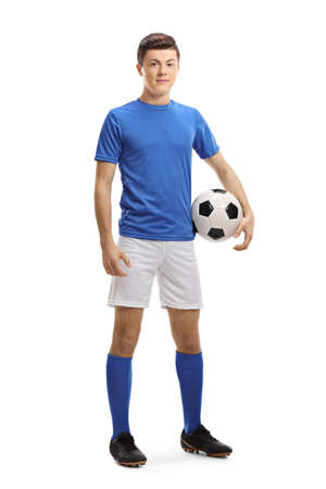 Photo pour Full length portrait of a teenager soccer player with a ball under arm isolated on white background - image libre de droit