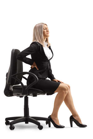 Photo pour Young woman at work with a painful lower back sitting on a chair isolated on white background - image libre de droit