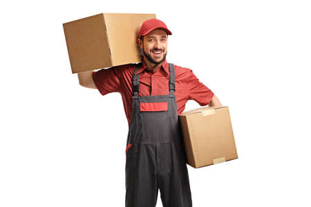 Photo pour Male worker holding two cardboard boxes isolated on white background - image libre de droit