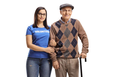 Photo pour Woman volunteer standing with a senior male pensioner with a walking cane isolated on white background - image libre de droit