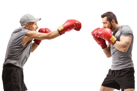 Photo for Elderly man and a young man boxing isolated on white background - Royalty Free Image