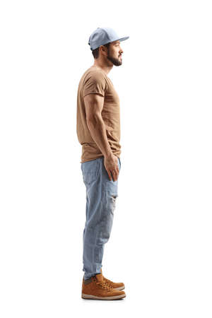 Photo pour Full length profile shot of a guy with a cap standing isolated on white background - image libre de droit