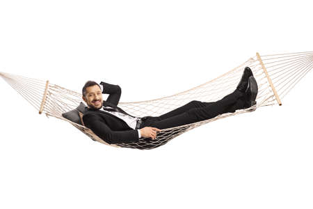 Photo for Happy young businessman lying on a hammock swing isolated on white background - Royalty Free Image