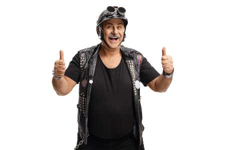 Photo pour Mature man biker with a leather vest showing both thumbs up - image libre de droit