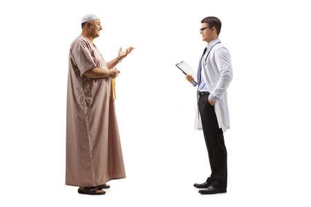 Photo pour Full length profile shot of a muslim man talking to a doctor - image libre de droit