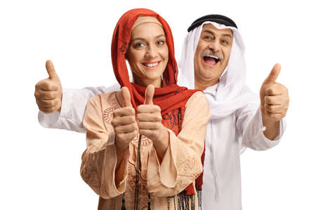 Photo pour Young muslim woman and a mature arab man gesturing thumbs up - image libre de droit