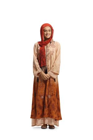 Photo pour Full length portrait of a young muslim woman in traditional clothes - image libre de droit