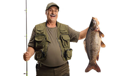 Photo pour Happy fisherman holding a big carp fish and smiling isolated on white background - image libre de droit