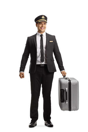 Photo pour Full length portrait of a hotel porter carrying a suitcase isolated on white background - image libre de droit
