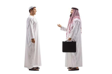 Photo pour Full length profile shot of arab men having a conversation isolated on white background - image libre de droit