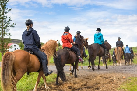 Group of horseback riders in Iceland. Travel beautiful country
