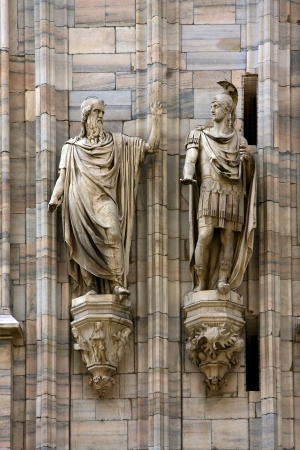 two statue in the church in milano