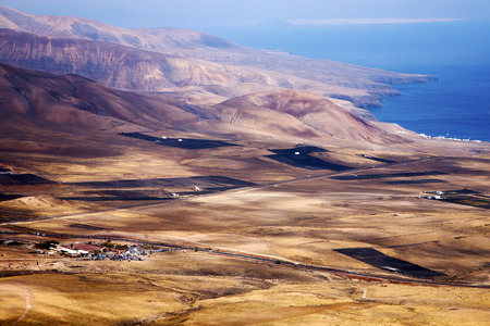 lanzarote view from the top in  spain africa and house field coastline