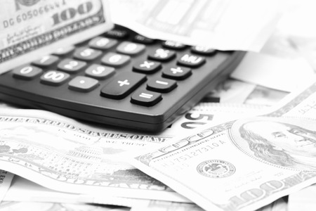 blurred calculator dollar and euro  money background like concept of differences success prosperity and business