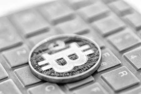 in the keyboard of a computer the coin of bitcoin like concept of future and investment
