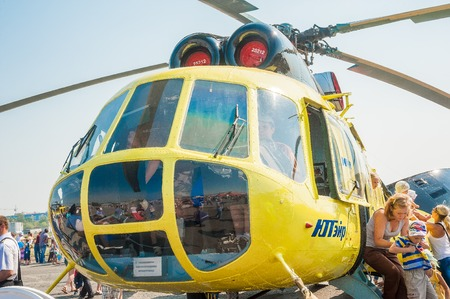 Tyumen, Russia - August 11, 2012  Air show  On a visit at UTair  in heliport Plehanovo  Visitors exploring the MI-8 helicopter