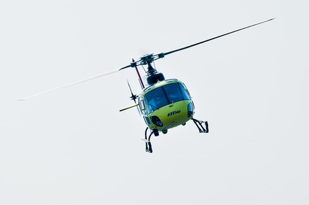 Tyumen, Russia - August 11, 2012: On visit at UTair airshow in heliport Plehanovo. Piloting of Eurocopter AS-350 shows flying opportunities. Facade view