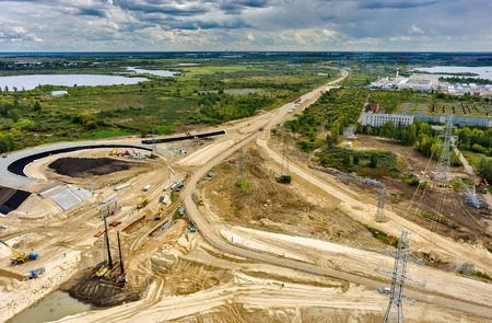 Photo for Tyumen, Russia - August 29, 2015: Aerial view of East Round road construction near bridge over Tura river - Royalty Free Image