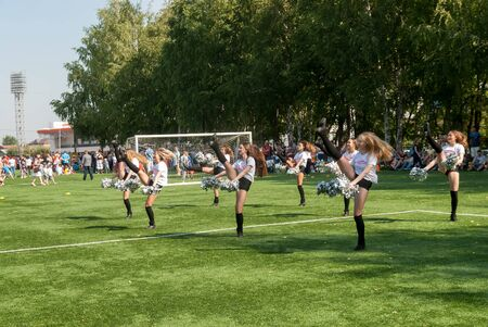 Tyumen, Russia - January 3, 2018: Football tournament among kindergartens at Geolog stadium. Cheerleaders in action