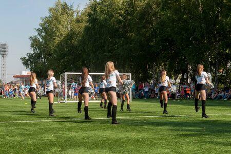 Tyumen, Russia - January 3, 2018: Football tournament among kindergartens at Geolog stadium. Performance of beautiful young girls of cheerleader team