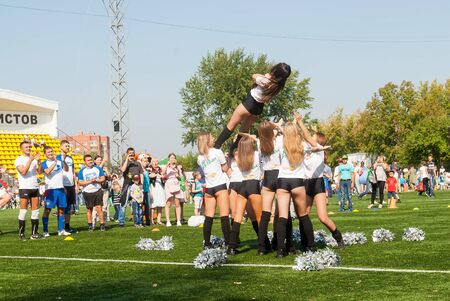 Tyumen, Russia - January 3, 2018: Football tournament among kindergartens at Geolog stadium. Cheerleaders in action