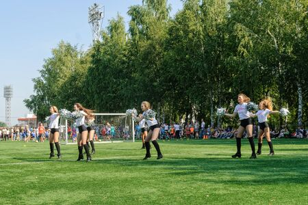 Tyumen, Russia - January 3, 2018: Football tournament among kindergartens at Geolog stadium. Performance of beautiful young girls of cheerleader team