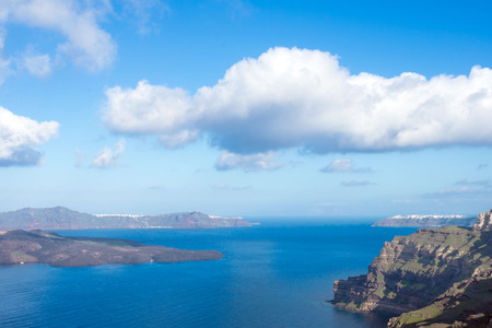 Photo for Beautiful view of the sea, the caldera and the island. Early morning on the island of Santorini, Greece. Panorama. - Royalty Free Image