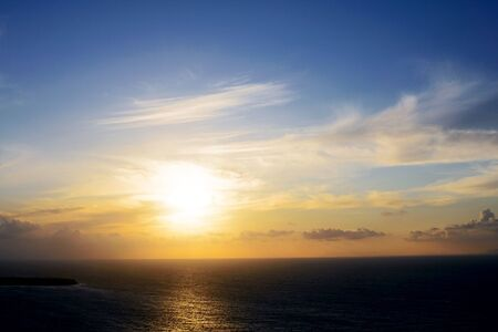 Photo pour The bright sun against the background of clouds, sky and sea at dusk. Sunset at sea. - image libre de droit