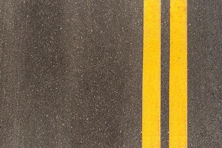 Photo pour Black asphalt road texture with marking background. Double yellow line on asphalt road. - image libre de droit