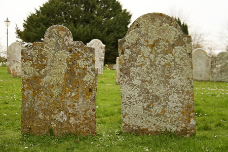 old grave stones in a cemetery,